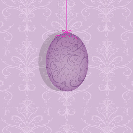 Pretty decorated Easter egg suspended on a pink ribbon