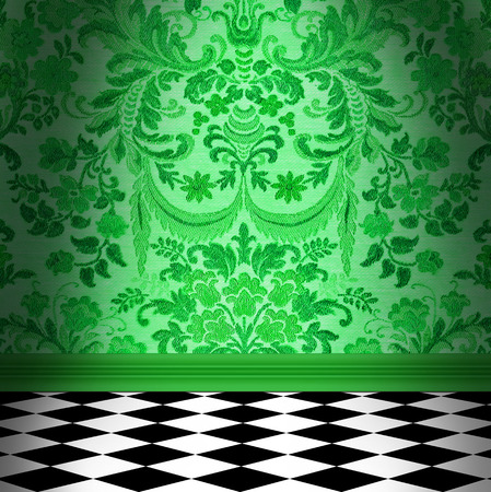 Dramatic room with green flocked damask wallpaper and black and white checkerboard floor Stock Photo