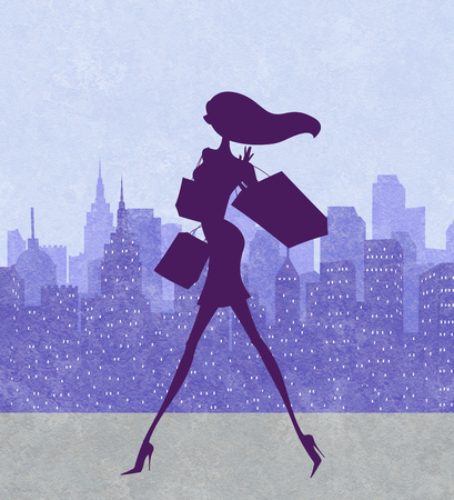 Fashion silhouette of a chic young shopper with a city skyline in the background Stock Photo