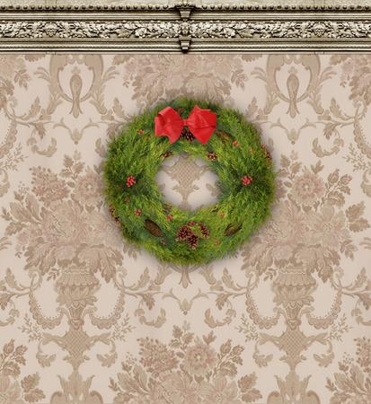 Christmas wreath on a wall with rich tan damask wallpaper Zdjęcie Seryjne