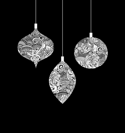 Ink drawing of three Christmas ornaments of intricate line work white on black