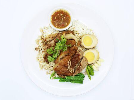 Rice with pork leg THAI food background.