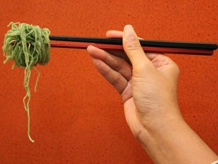 Noodle green background. Stock Photo