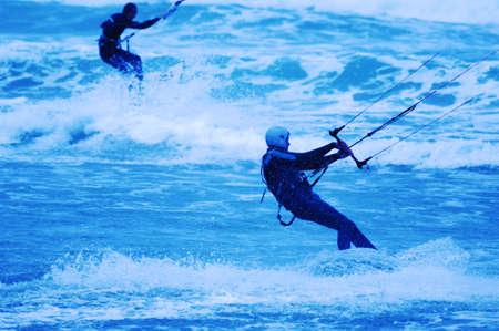 Kite surfer on blue background