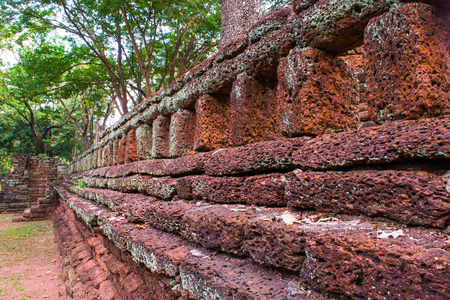 The old temple wall in Kamphaengphet Historical Park. Editorial