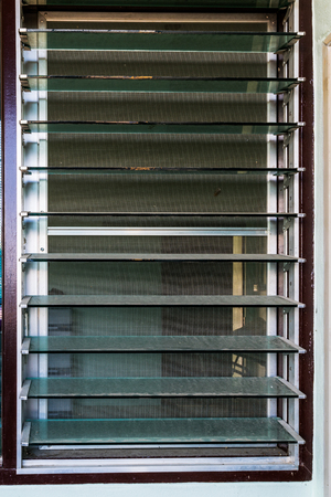 Tilt view of louvered structural glass