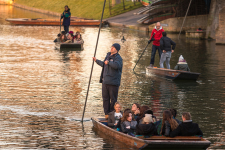punting: Cambridge, UK -- Feb 8, 2015: Groups of Tourism punting on the boats Editorial