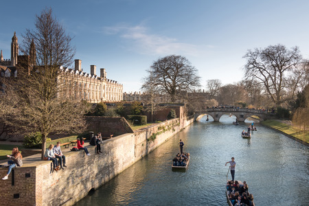 punting: Cambridge, UK -- Mar 7, 2015: Weekend Relaxing Punting Scene in the river behind King