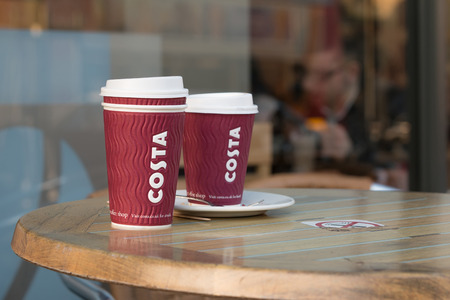 Two Costa Coffee Cups On The Wood Table Stock Photo Picture And - Costa coffee table