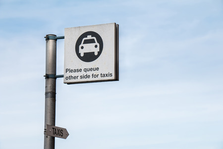 to the other side: Traffic Sign: Taxi Logo - Please Queue Other Side for Taxis in Blue Sky