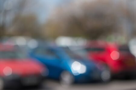 car parking: Blurred Bokeh of Cars parked in Parking Lots