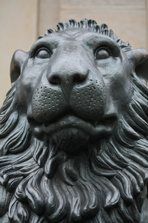 statue of male lion head in black color