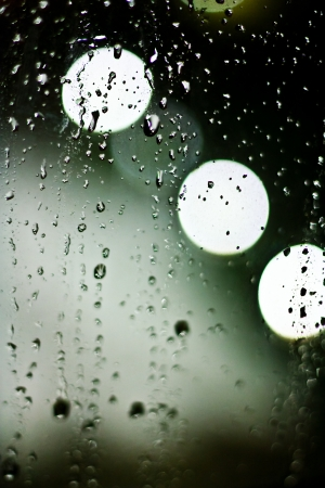 abstract bokeh with rain drop taken through the window