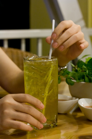 A glass of ice yellow tea