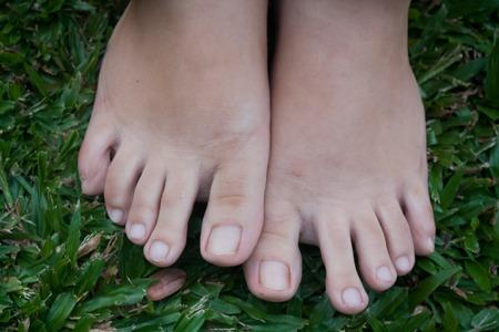 feet step on the grass photo