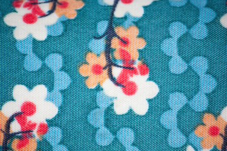 green textile background with flower