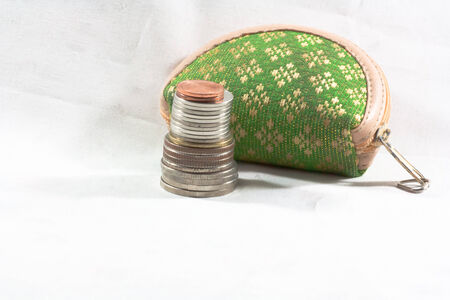 mini green purse with several coins
