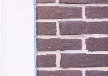 brown brick wall with white gap space between block