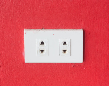 electrical outlet on red wall