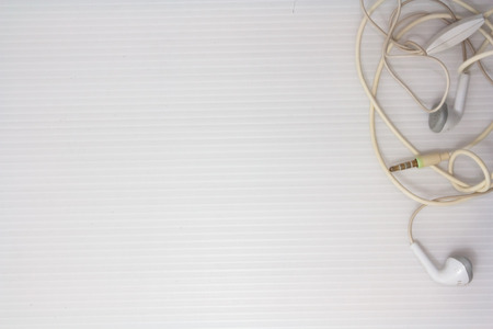 white headphone cable on white background