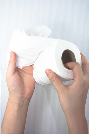 hand holding a tissue roll