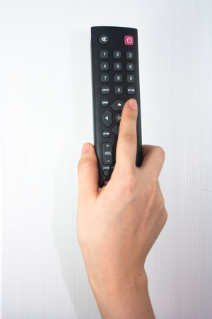 hand holding black remote control