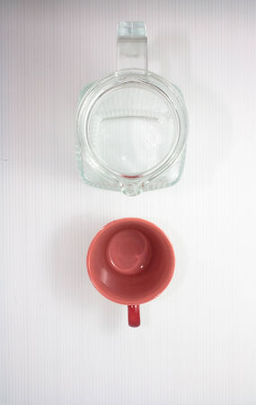 top view of empty glass jug on white background