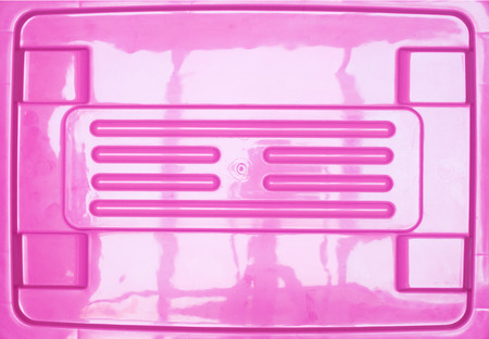 tupperware: pink background from plastic box cover Stock Photo