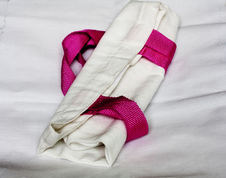 pink and white textile shopping bag
