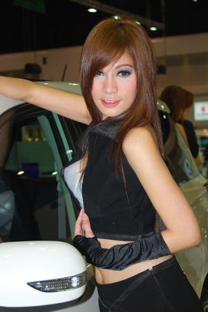 sexy asian woman: woman motor show Editorial
