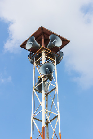 Speaker on high tower clear blue sky