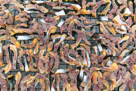 The dried Iridescent shark or Striped catfish or Sutchi catfish photo