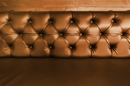 background with close-up of  dark brown  leather seal. photo