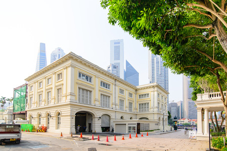 cultural artifacts: SINGAPORE - OCT 19, 2014: Asian Civilisations Museum in Singapore. Collection includes artifacts reflecting the cultural background of Singapore including ceramics, basketry, and textiles.