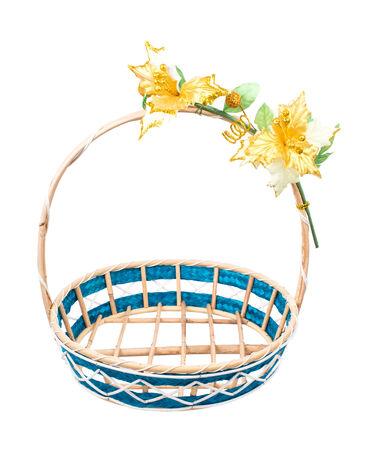 Empty wicker basket with flower on white background. photo