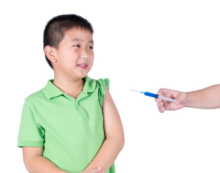 timorous: A fearful boy wearing green t-shirt  be afraid syringe.