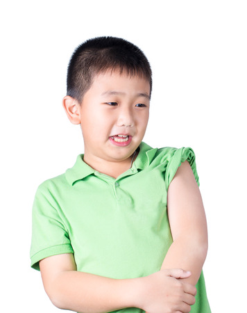 timorous: A fearful boy wearing green t-shirt  look at his left side