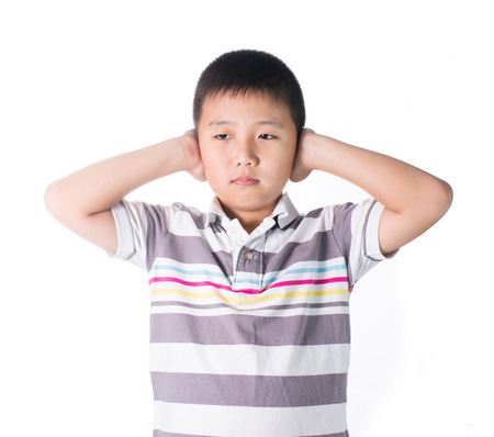 annoyance: Boy hands off covering ears from loud noise, squeezing head with hands, having headache, Conflict resolution isolated on white background. Stock Photo