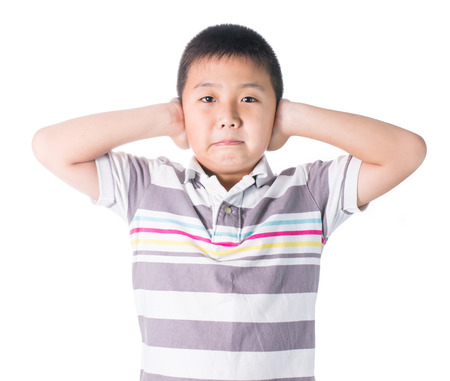 loud noise: Boy hands off covering ears from loud noise, squeezing head with hands, having headache, Conflict resolution isolated on white background. Stock Photo