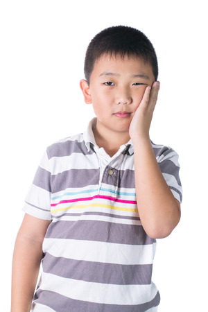 amalgam: Boy having a toothache holding his face with his hand, isolated on the white background Stock Photo
