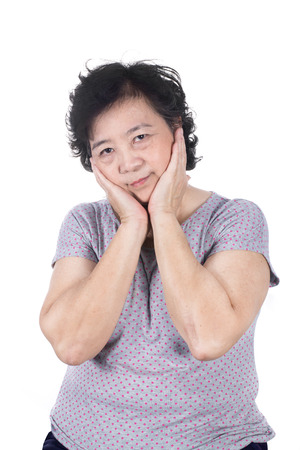 amalgam: Asian senior female having a toothache holding his face with her hand, isolated on the white background. Stock Photo
