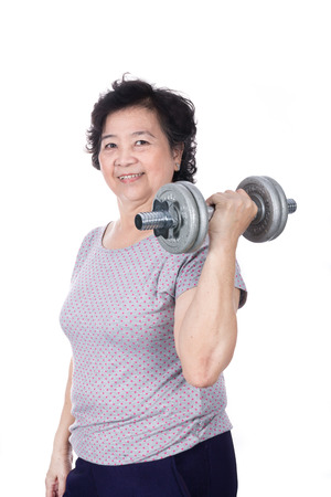 Asian strong senior woman lifting weights, isolated on white background. Imagens