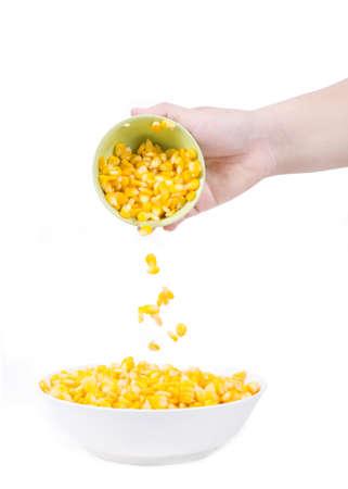Sweet corn in white bowl ready for eat with hand and spoon. photo