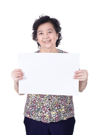 Asian senior female standing with empty horizontal blank paper in hands isolated on white background. photo