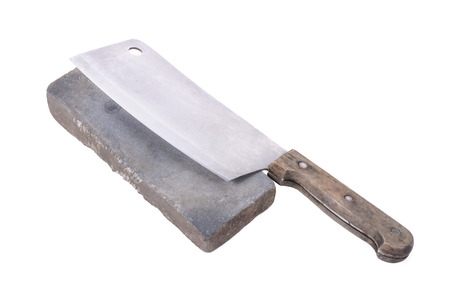 Sharpening or honing a knife on a waterstone, grindstone on the white background.