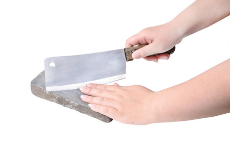 Sharpening or honing a knife on a waterstone, grindstone in woman hand on the white background. Stock Photo
