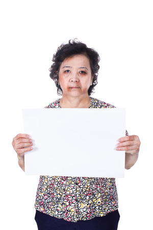 mistreatment: Senior abuse or elder mistreatment with a black eye bruised and injured holding empty horizontal blank paper.