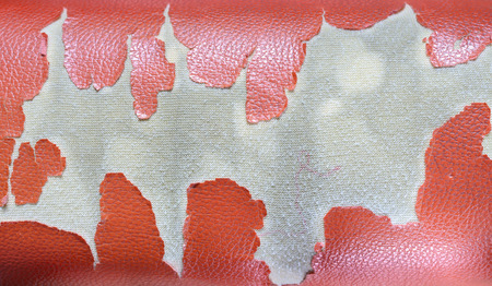 tatter: Old bad condition artificial leather seats background.