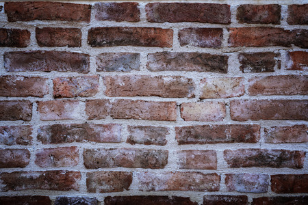 vignetted: ancient old red brick wall fragment with vignetted corners background, texture.