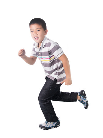 Asian boy running, isolated on white background. Archivio Fotografico
